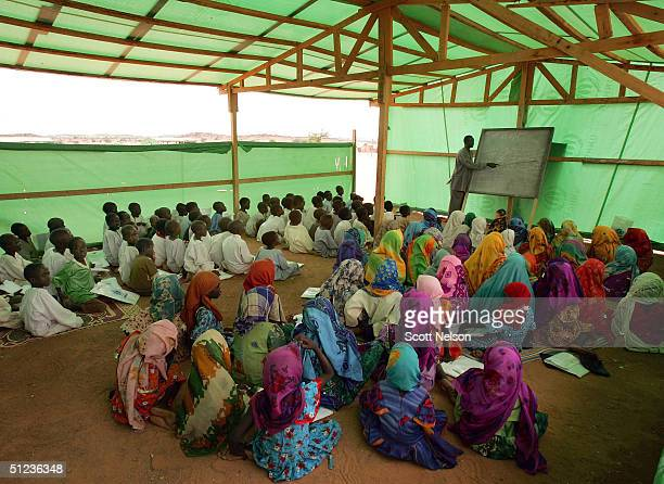 Sudanese refugee children attend a UNICEF sponsered school in the Farshana refugee camp August 29 2004 in eastern Chad More than 12000 Sudanese...