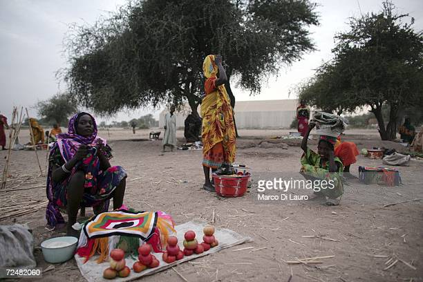 Sudanese refugee women sell what meagre goods they have at market on November 8 2006 in the Goz Amer Refugee Camp Chad Since 2004 refugees have fled...