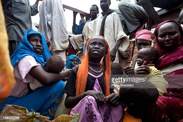 Sudanese refugees board a truck heading to Batil refugee camp July 15 2012 in Jamam camp South Sudan Up to 16000 refugees are in the process of being...
