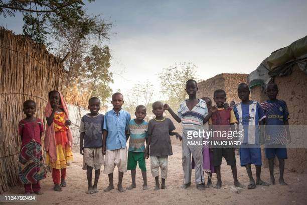 Sudanese refugees children pose for photographs in the Treguine camp in Hadjer Hadid in the Ouaddaï region of eastern Chad on March 24 2019 Since...