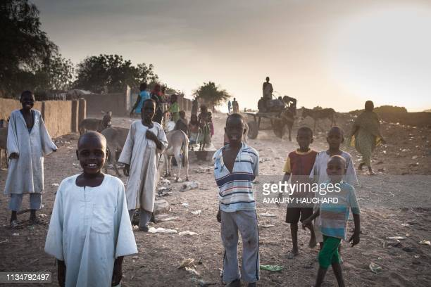 TOPSHOT Sudanese refugees children pose for photographs in the Treguine camp in Hadjer Hadid in the Ouaddaï region of eastern Chad on March 24 2019...
