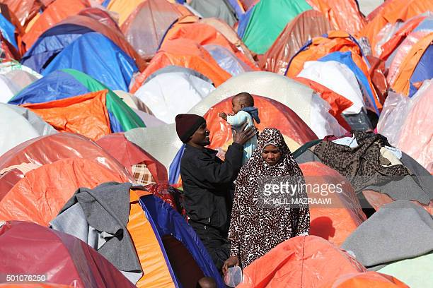 TOPSHOT Sudanese refugees from Darfur stand amid tents as they gather during an openended sitin outside the United Nations High Commissioner for...