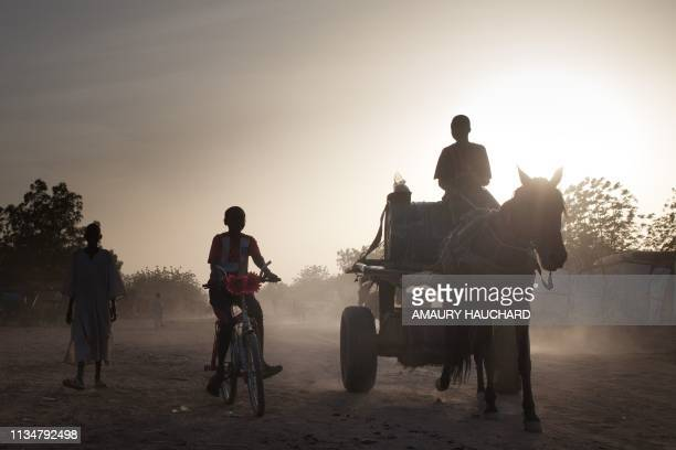 Sudanese refugees go about with their daily life in Treguine camp Hadjer Hadid in the Ouaddaï region of eastern Chad on March 24 2019 Since 2003 and...