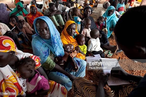 Sudanese refugees wait in line in the out patient department at the MSF field hospital July 17 2012 in Jamam refugee camp South Sudan Up to 16000...