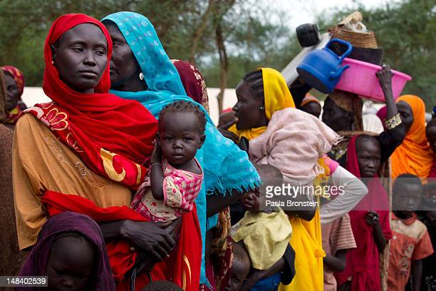 Sudanese refugees wait in line to board a truck heading to Batil refugee camp July 15 2012 in Jamam camp South Sudan Up to 16000 refugees are in the...
