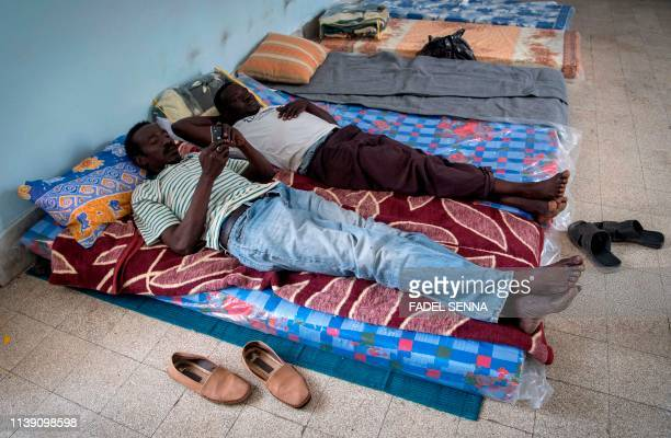 TOPSHOT Sudanese refugees who fled from the clashes between forces loyal to the internationally recognised Government of National Accord and forces...