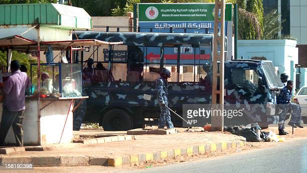Sudanese riot police are seen on standby near Nielien University in the capital Khartoum on December 11 2012 The area around Nielien university was...