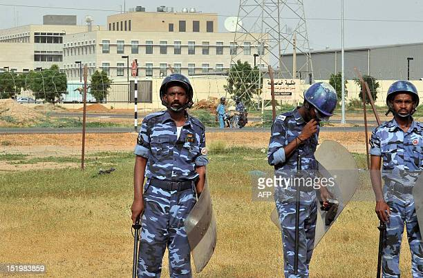 Sudanese riot policemen stand guard outside the US embassy in Khartoum during a protest against an amateur film mocking Islam on September 14 2012...