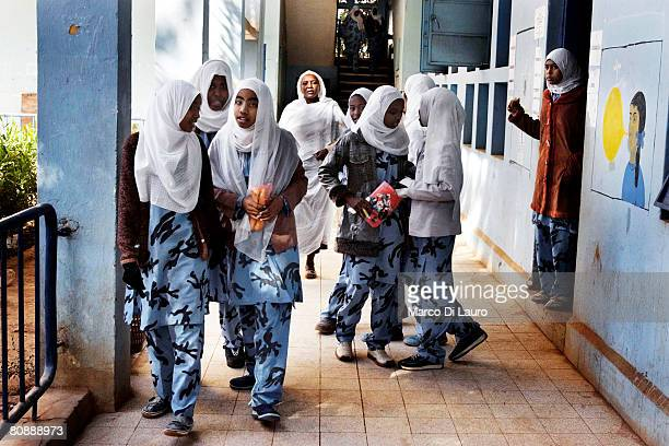 Sudanese school girls wearing a military style camouflage uniform are seen during a break in between classes on January 16 2007 in Khartoum Sudan...