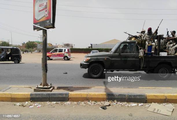 Sudanese security forces drive through a main road linking Omdurman with its twin city Khartoum on the first day of a civil disobedience campaign...