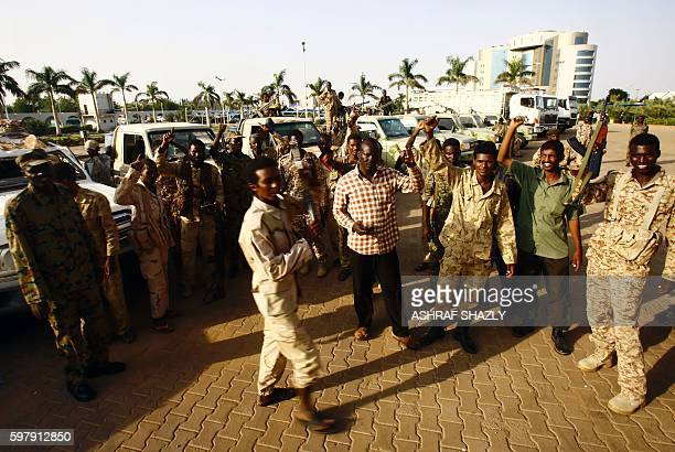 Sudanese security forces pose for a photo outside the defence ministry in the capital Khartoum on August 30 2016 as some 800 African migrants...