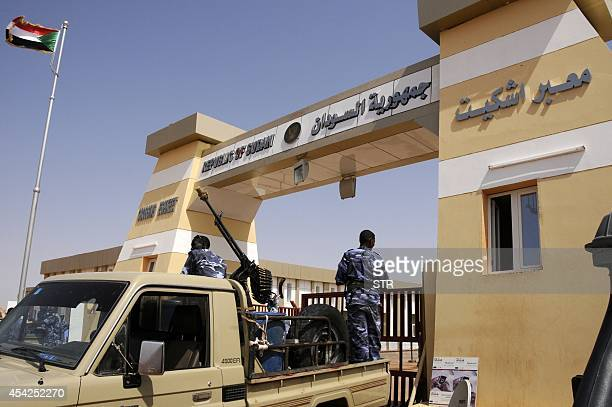 Sudanese security forces secure the newlyopened EshkeetQastal land crossing between Sudan and Egypt on August 27 2014 According to the Egyptian press...