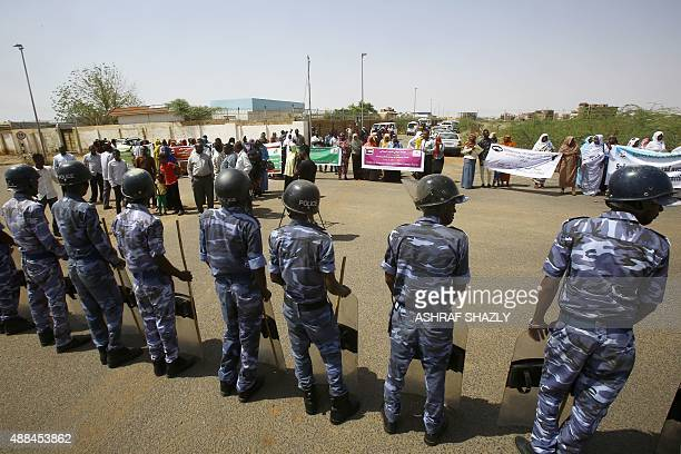 Sudanese security forces stand guard outside the US embassy in Khartoum on September 16 during a protest organised by representatives of various...