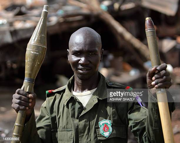 A Sudanese soldier looks on as he holds a rocketpropelled grenade in Sudan's oil town of Heglig on April 23 2012 Sudan's army claimed that more than...