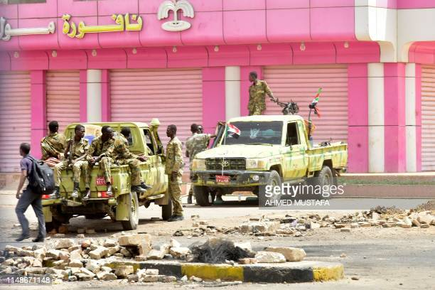 Sudanese soldiers stand guard a street in Khartoum on June 9 2019 Sudanese police fired tear gas Sunday at protesters taking part in the first day of...