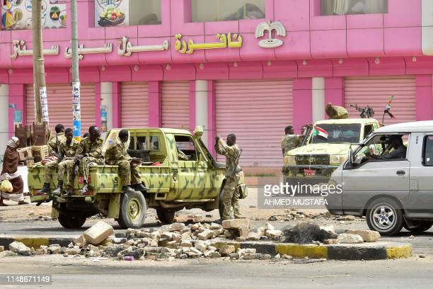 Sudanese soldiers stand guard a street in Khartoum on June 9, 2019. - Sudanese police fired tear gas Sunday at protesters taking part in the first...