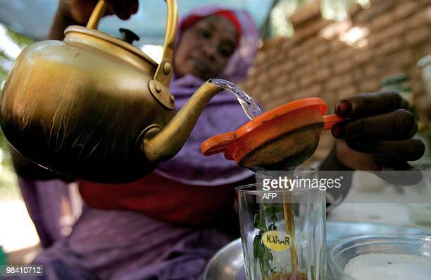 Sudanese street vendor serves tea to a customer in Khartoum on April 12 2010 Sudanese nationwide are voting for president as well for legislative and...