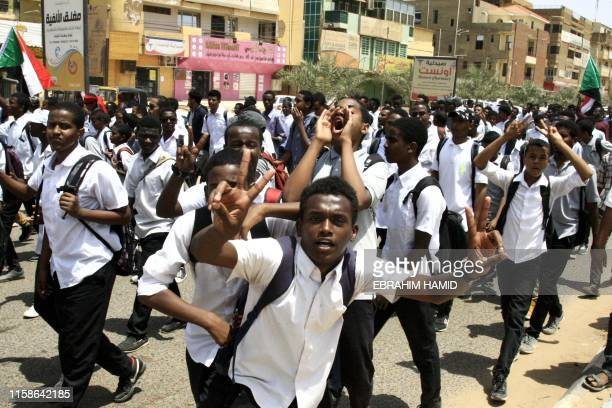 Sudanese students protest in the capital Khartoum on July 30 a day after teenagers were shot at a rally against shortages of bread and fuel in the...