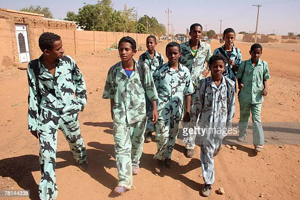 Sudanese students walk home past the Wad Nobawi mosque in Omdurman west of Khartoum 29 November 2007 A British teacher appeared before a heavily...