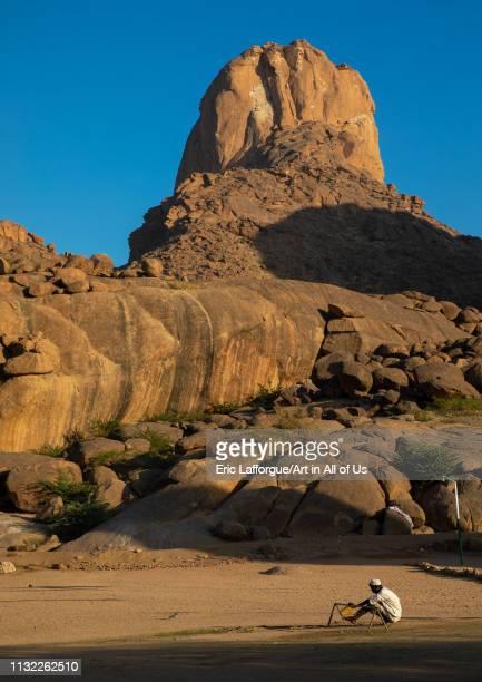 Sudanese sufi man praying at the foot of Taka mountains, Kassala State, Kassala, Sudan on January 2, 2019 in Kassala, Sudan.