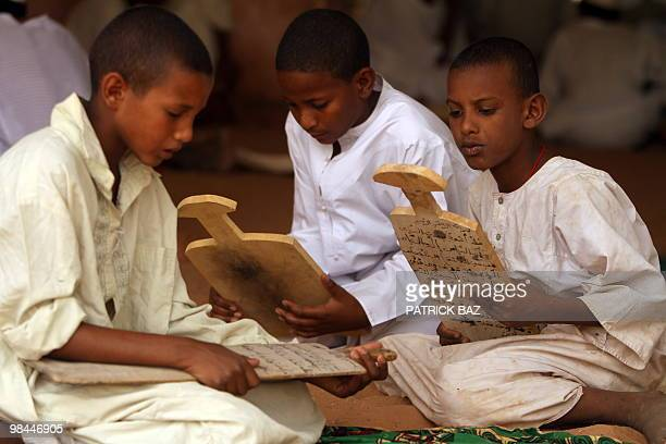 Sudanese Sufi students hold their wooden boards or Lawha as they recites verses of the Koran at the Qadiriya Badiriya Sufi mosque in the village of...