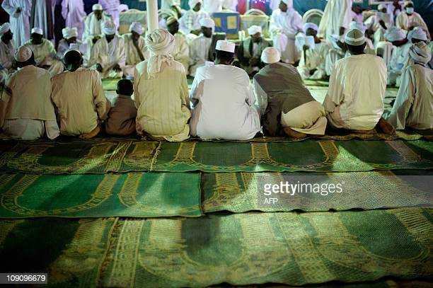 Sudanese Sufis gather during a festival commemorating the birth of Islam's Prophet Mohammed known in Arabic as Mawlid alNabawi at the Mulid square in...