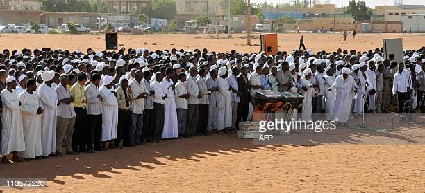 Sudanese sympathizers hold prayers on May 3 in Khartoum led by Zaid Mohammed Hamza the head the Islamist local group in remembrance of the late...