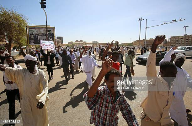 Sudanese take part in a demonstration against French satirical weekly Charlie Hebdo for publishing a cartoon of the Muslim prophet Mohammed on...