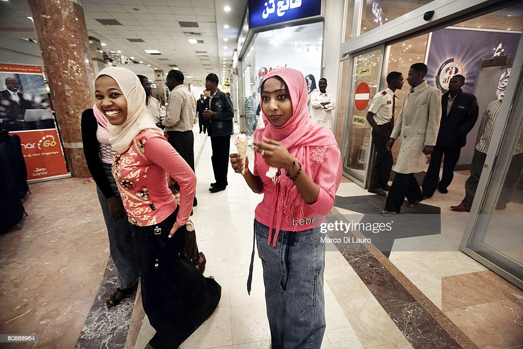 sudanese teenagers walk around the afra shopping mall on