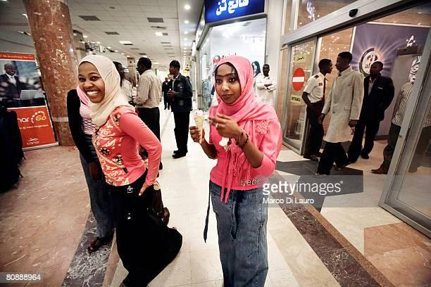 Sudanese teenagers walk around the Afra Shopping Mall on January 11 2007 in Khartoum Sudan Afra Mall is the first shopping mall in Sudan Opened on...