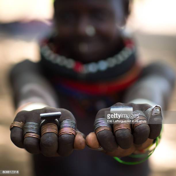 Sudanese Toposa tribe girl refugee showing her hand rings Omo Valley Kangate Ethiopia on June 9 2017 in Kangate Ethiopia