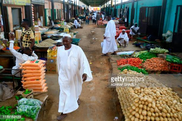 Sudanese vendors sell vegetables in the central market of Khartoum on June 10 as most of the shops and businesses remained shut. - Residents...