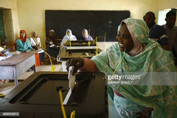 A Sudanese woman casts her vote at the AlDaim East school turned into a polling station in the capital Khartoum on April 13 2015 With 15 littleknown...