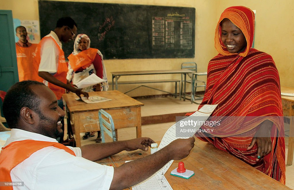 A Sudanese woman registers to cast her ballot at a voting station in Khartoum on June 5, 2010 during a re-election in some geographical constituencies for the Sudanese parliament.