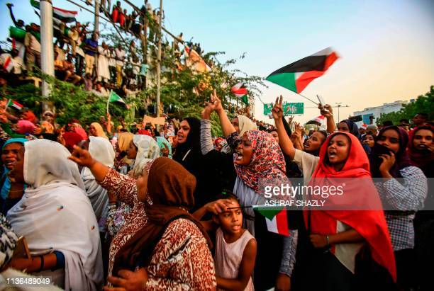 Sudanese women chant slogans during a demonstration demanding a civilian body to lead the transition to democracy, outside the army headquarters in...