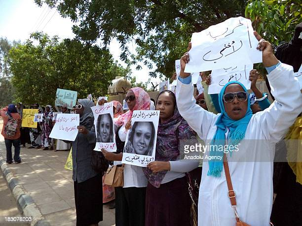 Sudanese women hold banners with portraits of their relatives on October 03 2013 in Khartoum Sudan Sudanese women whose relatives were detained...