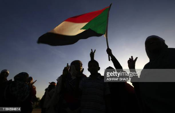 TOPSHOT Sudanese women march in Khartoum to mark International Day for Eliminating Violence against Women in the first such rally held in the...