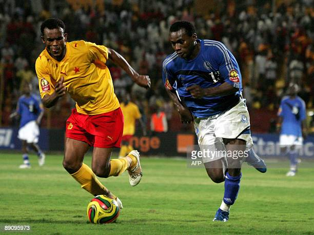 Sudan's AlHilal club player Ambili vies with Sari of AlMarikh club during their African Champions League football match in Omdurman near Khartoum on...