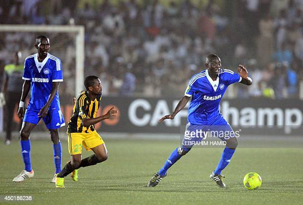 Sudan's AlHilal Omdurman player Nassir Nazar snatches the ball from DR Congo's AS V Club's Deogracias Mukok during the CAF Champions league football...