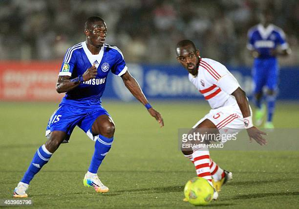 Sudan's ElHilal Cisse Souleymane and Egypt's Zamalek footballer Gaber Omar vie for the ball during their Group A CAF Champions League football match...