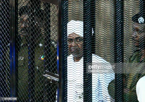 Sudan's expresident Omar alBashir appears in court in the capital Khartoum on August 31 2019 to face charges of illegal acquisition and use of...