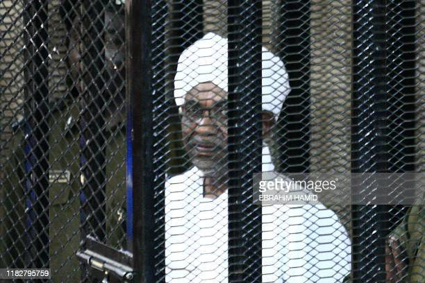 Sudan's ex-president Omar al-Bashir appears in court in the capital Khartoum on August 31, 2019 to face charges of illegal acquisition and use of...