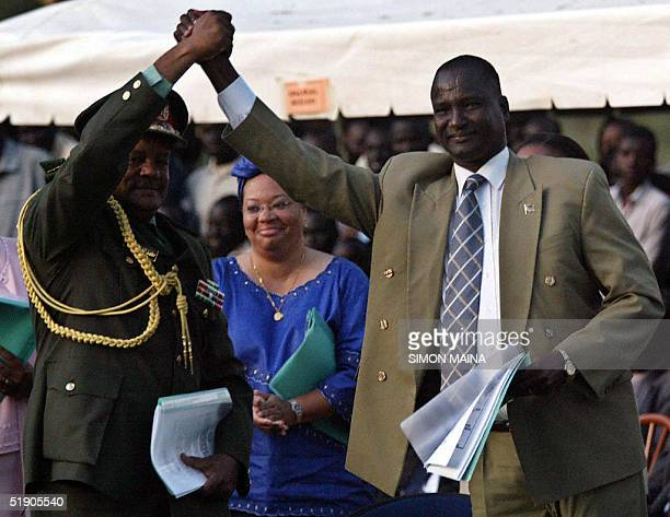 Sudan's General Mohamed Hassan elFadow shakes hands with Sudan's People Liberation Movement/Army Commander Taban Deng after they signed accords on...