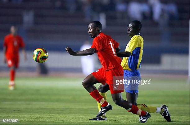 Sudan's Haytham Kamal Tambal fights for the ball against an unidentified Chadian player during their group ten African Nations Cup qualifying match...