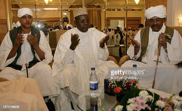Sudan's Janjaweed militia leader Mussa Hilal Abdullah Nagi representative of Chadian President Idriss Deby and Sudanese President Omar alBashir pray...