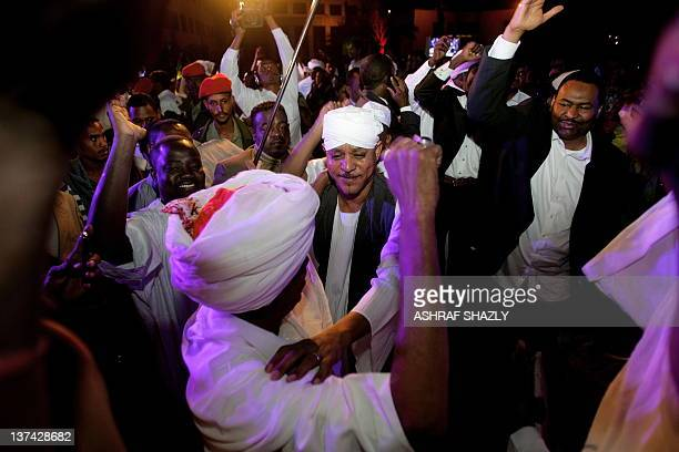 Sudan's Janjaweed militia leader Mussa Hilal dances during the wedding of his daughter Amani and Chadian President Idriss Deby in Khartoum on January...