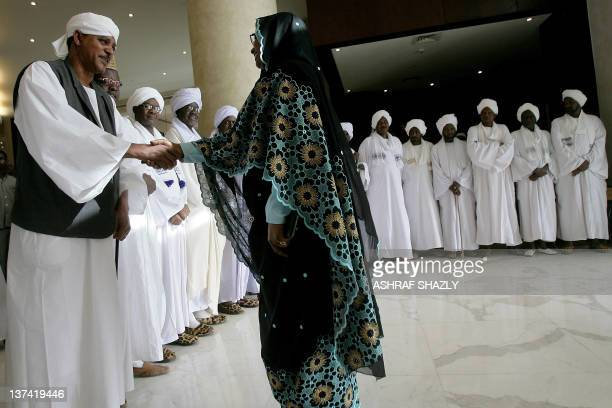 Sudan's Janjaweed militia leader Mussa Hilal is congratulated by a guest during an official ceremony celebrating the marriage of his daughter Amani...
