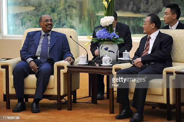 Sudan's leader Omar al-Bashir listens to China's Chairman of the Standing Committee of the National People's Congress Wu Bangguo during their meeting...