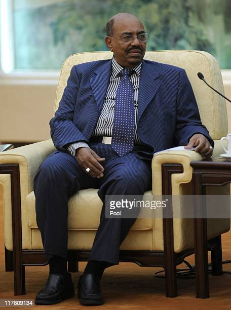 Sudan's leader Omar al-Bashir meets China's Chairman of the Standing Committee of the National People's Congress Wu Bangguo at the Great Hall of the...
