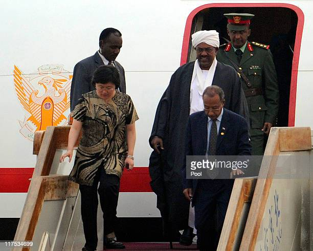 Sudan's leader Omar al-Bashir walks out from the airplane as he arrives at Beijing International Airport on June 28, 2011 in Beijing, China. Sudan's...